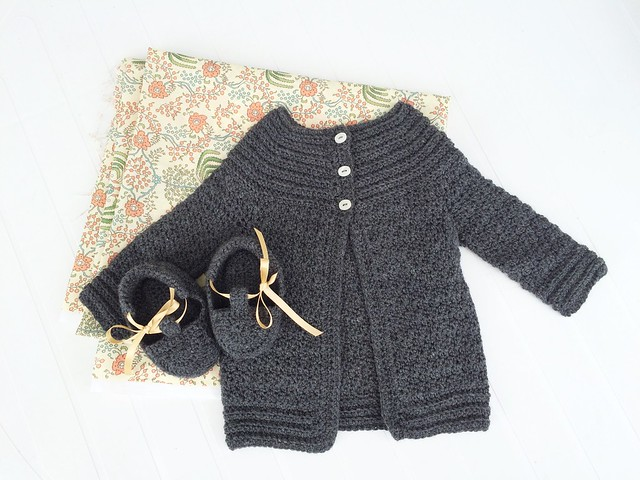 Baby cardigan and booties with a dress to come.