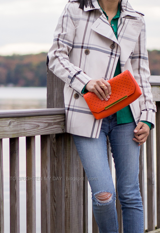 plaid patterned trench jacket, green blouse, orange clutch