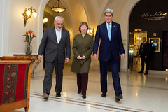 U.S. Secretary of State John Kerry, Baroness Catherine Ashton of the European Union, and Foreign Minister Javad Zarif of Iran approach awaiting photographers in Vienna, Austria, on November 20, 2014, before sitting down for a three-way discussion about the future of Iran's nuclear program. [State Department photo/ Public Domain]