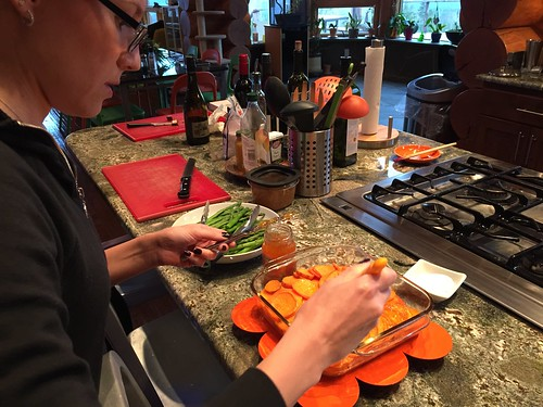 Mango glazing the sweet potatoes
