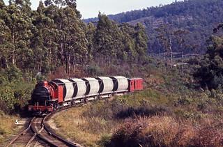 Photographed on 26 March 1970 of Tasmanian Railways H class No H 2 working a cement train from Railton to Devonport near Dulverton, Tasmania, Australia.