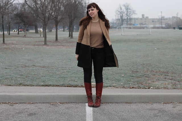 Black and tan outfit: high-waisted black jeans, partial-laceup leather Frye boots, J.Crew camel-colored cashmere long-sleeve tee, quartz necklace, Madewell black and tan colorblock streetcar coat