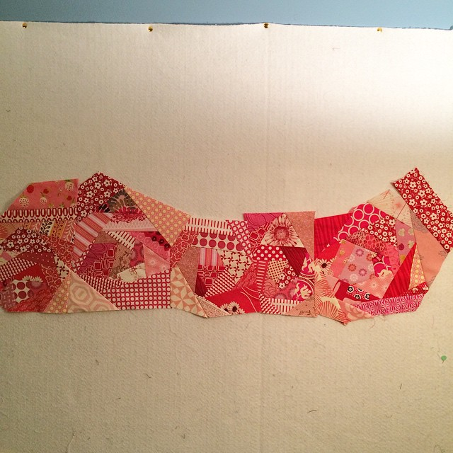 "My red scrappy improv blocks are now a 35"" strip. #Scraptastictuesday"
