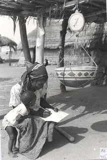 A young Fulani mother recording the scaled millet Powder. Northern Nigeria, 1989