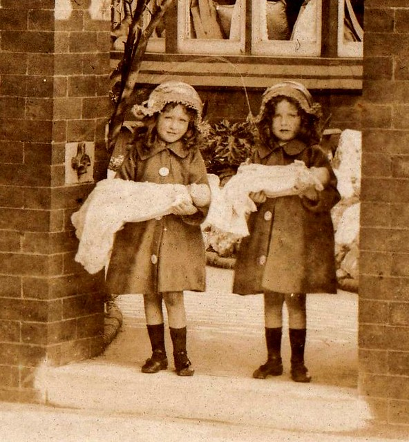 Detail of the two young girls and their dolls