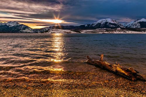 wood lake snow water clouds rockies evening log colorado rockymountains summitcounty lakedillon