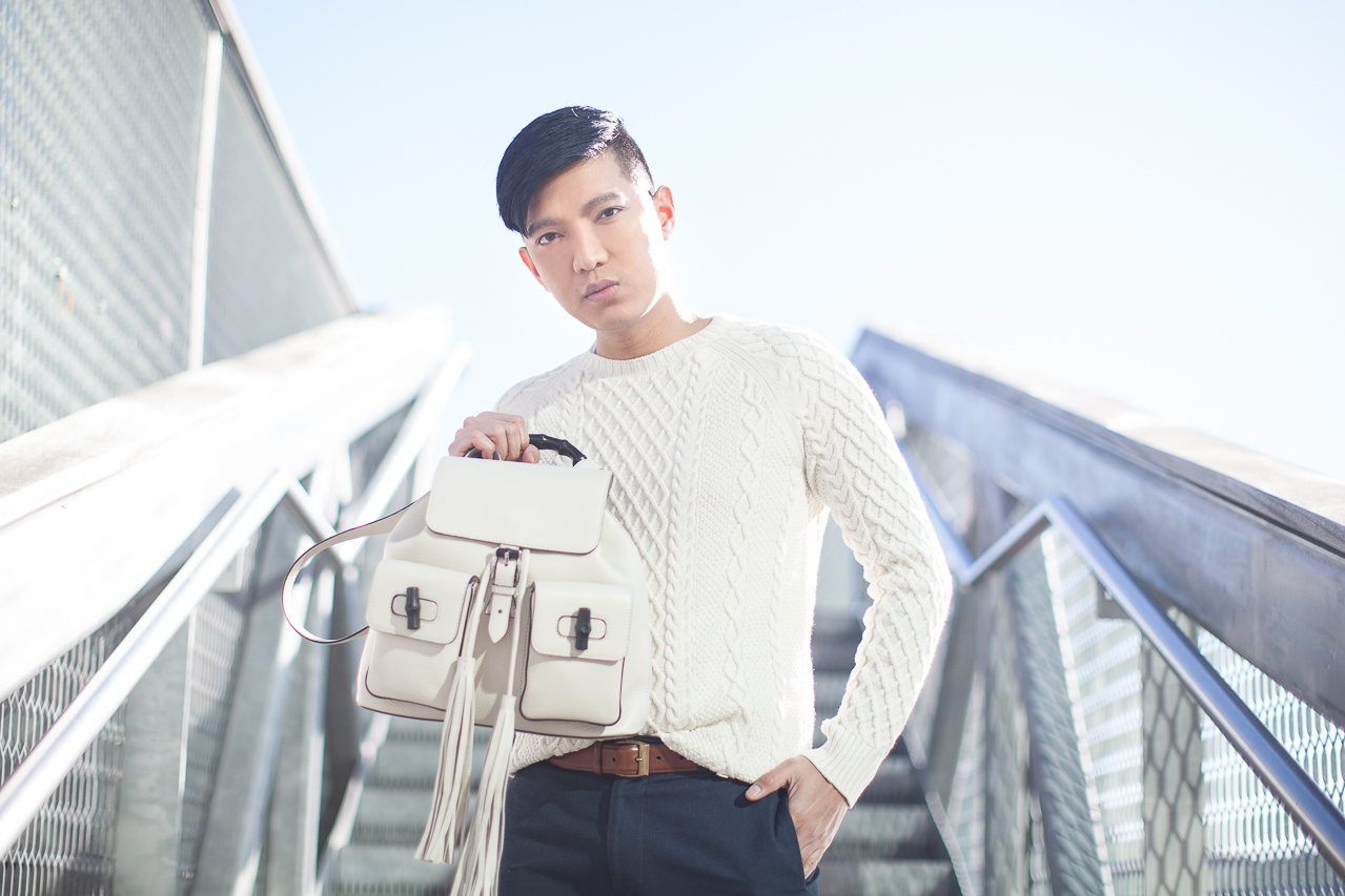 Bryanboy holding a white Gucci backpack