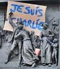 """Relief on monument Place de la République: """"Je suis Charlie"""" motto and pencil brandished as a weapon by a child. by Claudecf"""