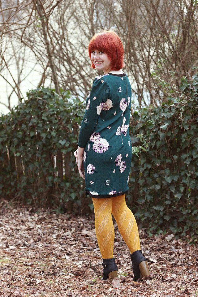 Green Floral Print Shift Dress, Yellow Patterned Tights, and Black Boots