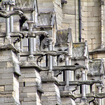medieval detail, a line of dramatic gargoyles project from the walls of the wonderful old Notre Dame de Paris, France