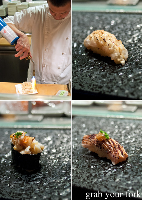 Chef Takashi Sano blowtorching scamp, aburi scampi, aburi salmon belly and kani miso crab brain sushi at Sokyo at The Star, Pyrmont