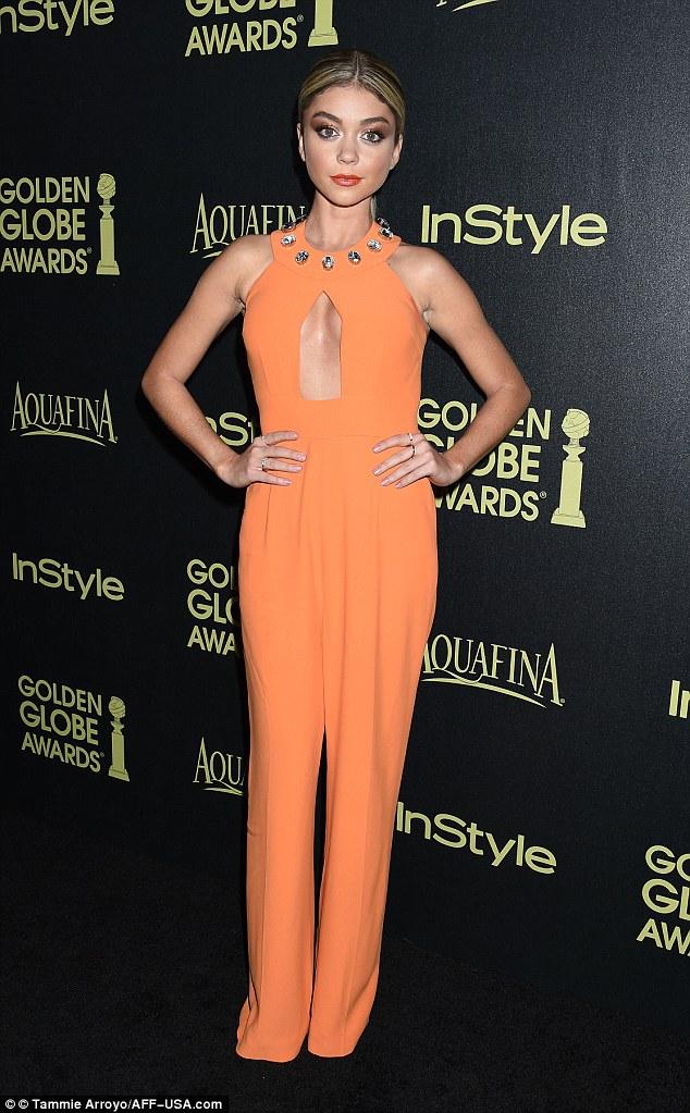 Sarah-Hyland-n-aorange-bejeweled-neckline-jumpsuit,Viktor & Rolf dress, orange strapless gown from Maticevski Resort 2015 collection, orange Viktor & Rolf dress