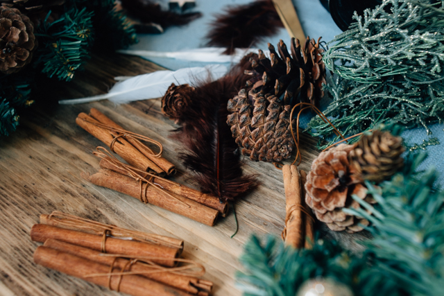 wreath making with spices and pine cones