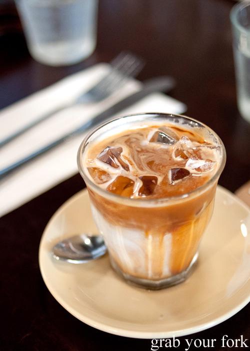 Iced black coffee with milk at Brewtown Newtown
