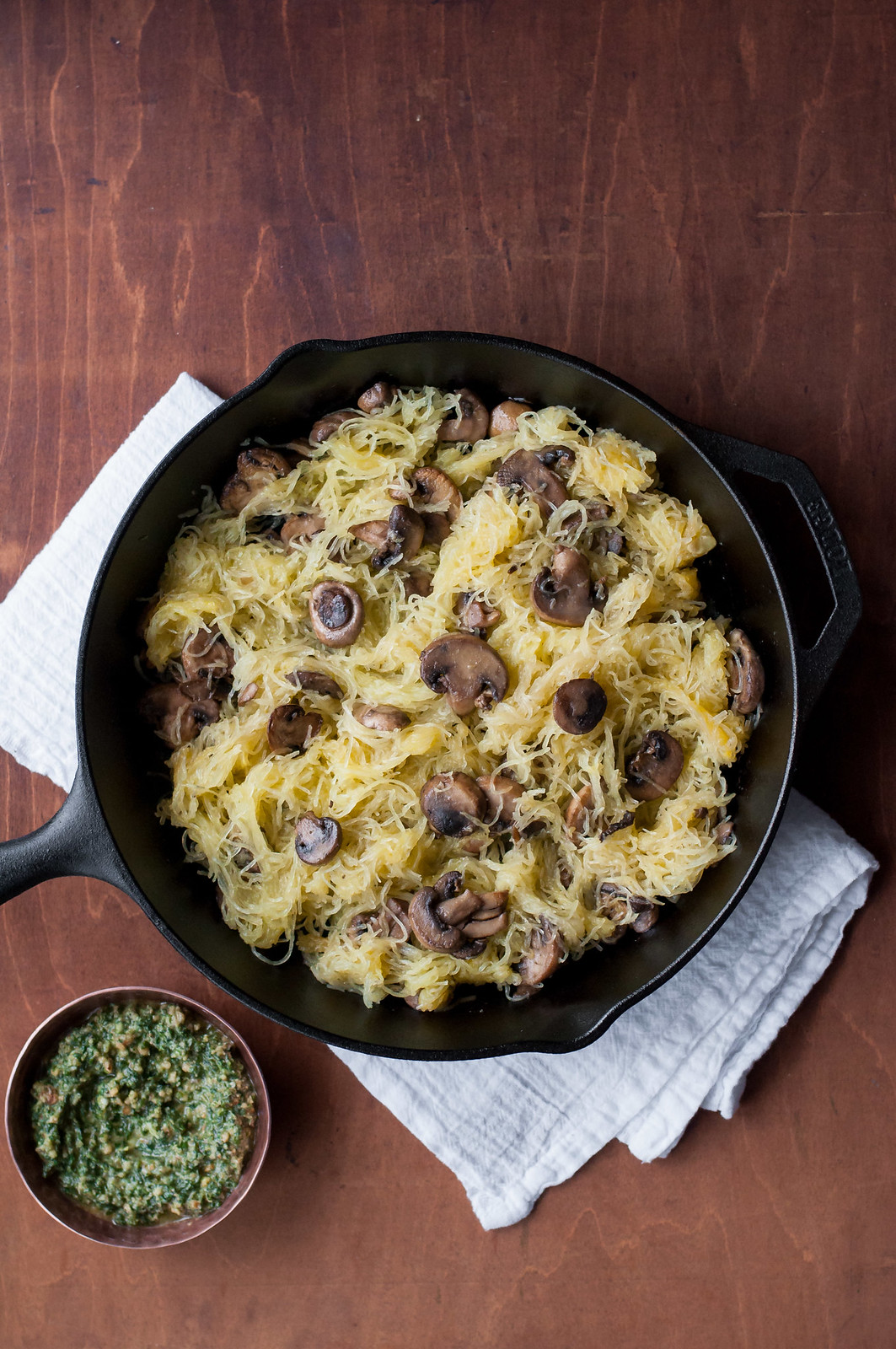 Spaghetti squash with handmade lemony pesto and mushrooms: an easy, meatless, and gluten-free weeknight dinner.