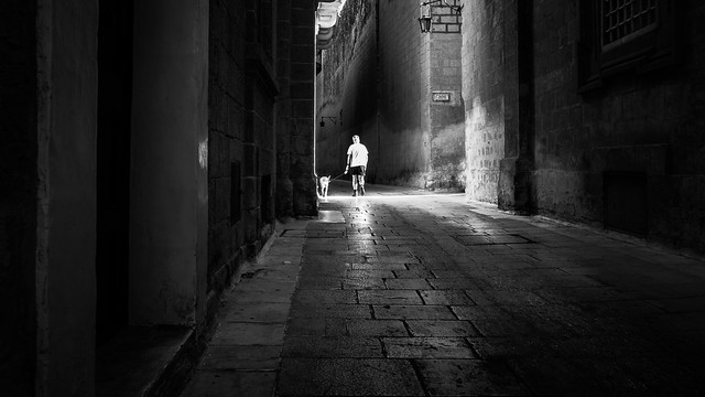 Walking the dog - Mdina, Malta - Black and white street photography