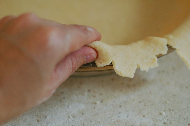 Rolling the edges of the pie crust under by Eve Fox, The Garden of Eating, copyright 2014