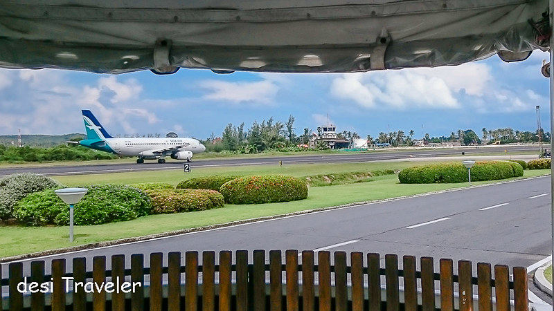Airplane at Koh Samui Airport that looks  like a Golf Resort