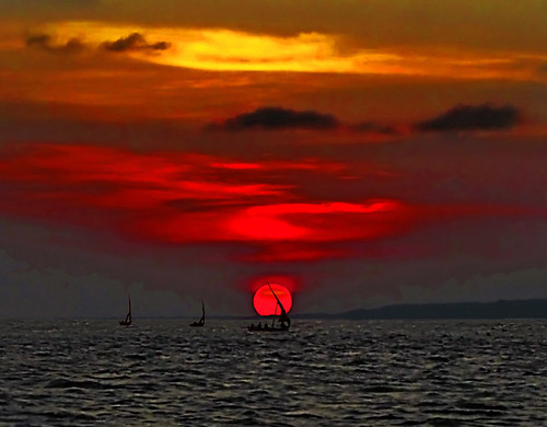 ocean sunset red sea sky orange sun seascape boats coast fishing sailing peace sundown kenya indian culture silhouettes calm series handcrafted lamu equator archipelago gettyimages dreamscape dhow swahili lplate mashua arabicstyled