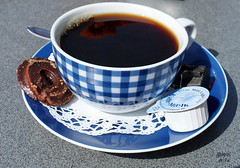 turkish coffee(0.0), espresso(1.0), cup(1.0), saucer(1.0), food(1.0), coffee cup(1.0), drink(1.0), caffeine(1.0),