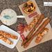 Cheese sticks, olive bread sticks, Mediterranean quiche