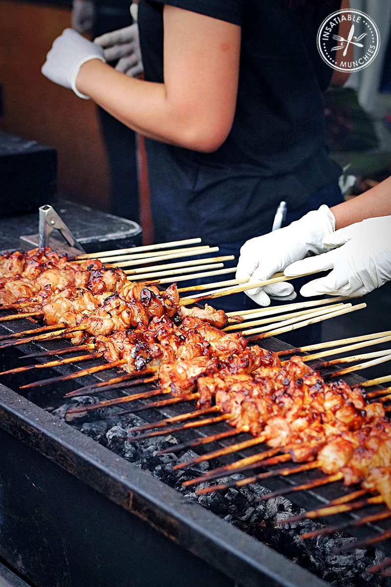 Skewers being barbecued at the Night Noodle Markets
