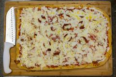 produce(0.0), cookware and bakeware(0.0), tarte flambã©e(1.0), pizza cheese(1.0), pizza(1.0), zwiebelkuchen(1.0), food(1.0), dish(1.0), cuisine(1.0),