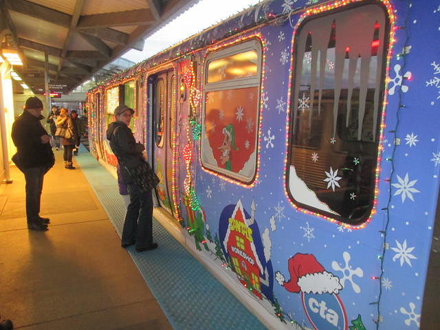 Yellow Line Holiday Train stops at Howard 'L' Station's northbound platform - looking south