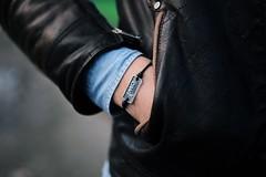spring(0.0), hand(1.0), arm(1.0), textile(1.0), leather jacket(1.0), clothing(1.0), leather(1.0), jacket(1.0), close-up(1.0), black(1.0),