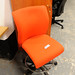 Orange high swivel chair