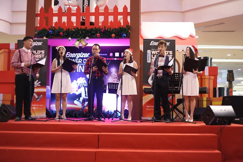 Christmas carollers add to the festivity