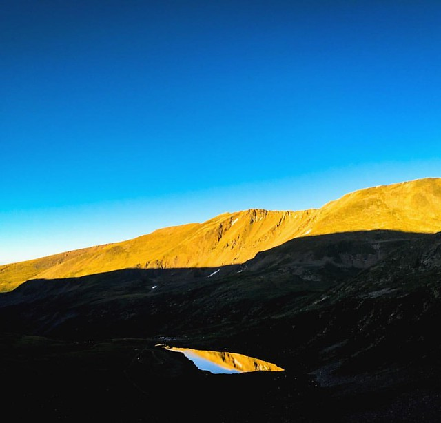 Get up early, meet the rising sun, reflect on the wonder of the hills. #colorado #14er #sunrise