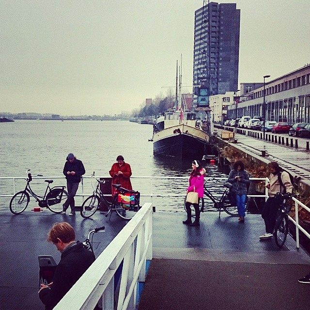 Cyclists checking their phone while waiting for the ferry #ilovenoord #amsterdamnoord #cycling #smartphone #cyclechic #bikeams #modernlife