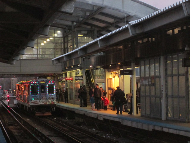 Yellow Line Holiday Train stops at Howard 'L' station's southbound platform