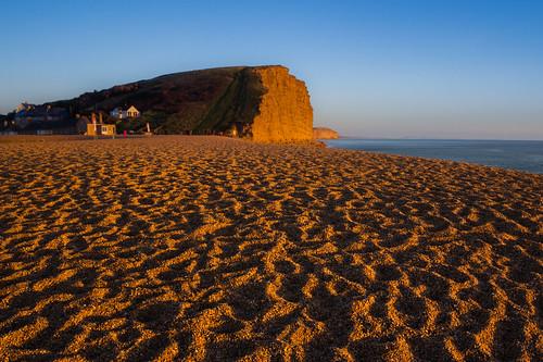 winter light west beach golden evening bay shingle cliffs dorset broadchurch
