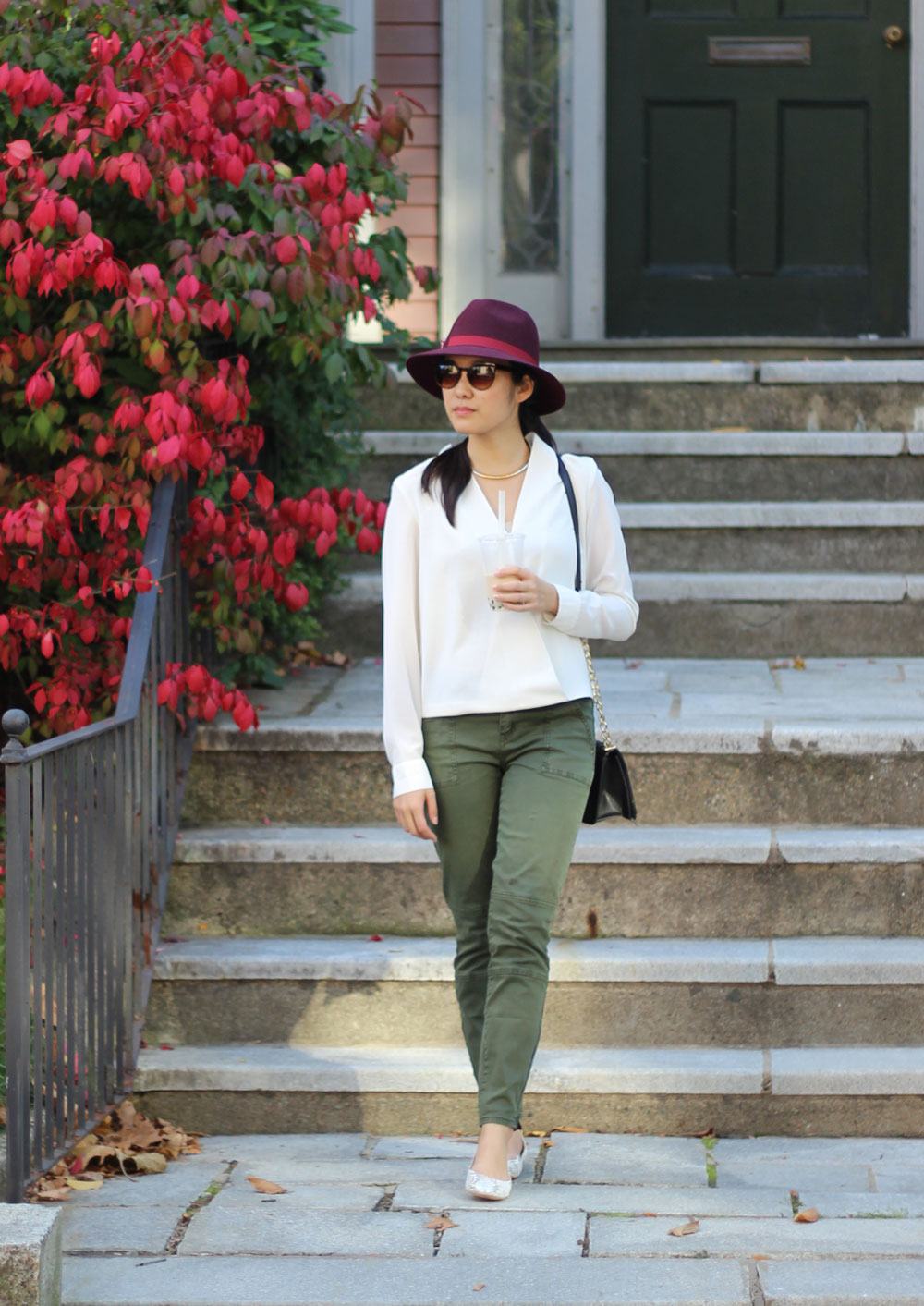 Fall casual look with maroon fedora, white wrap over blouse and green cargo pants