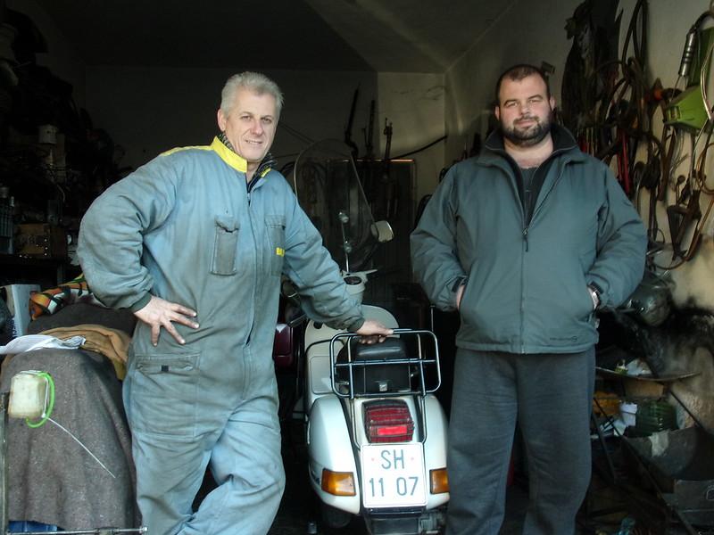 Dudes in a moto repair shop