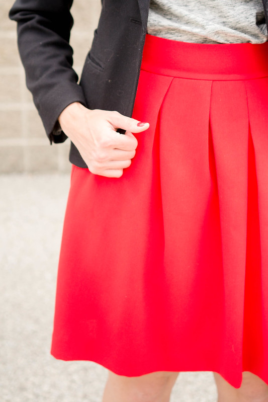 red orange skirt + gray tee + black accessories; creative work outfit | Style On Target
