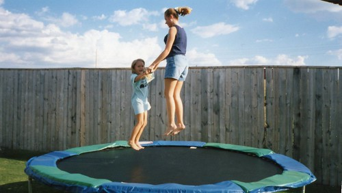 Brittny FLint-14 yrs; Carissa-7 yrs playing on the trampoline