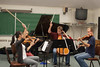 Beatrice Hsieh, Carolyn Semes, Zachary Mowitz, and Joseph Burke, from the Snitzer Quartet at Music Rehearsal