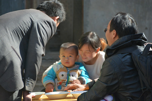 Picture of parenting trainers visiting mom and baby in rural China
