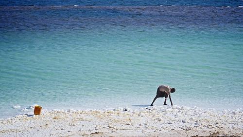 Djibouti worker extracting salt, Assal Lake, Djibouti