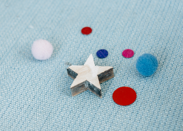wooden star and sequins on blue laura ashley fabric