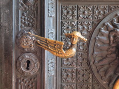 furniture(0.0), wood(0.0), door knocker(0.0), carving(1.0), art(1.0), metal(1.0), stone carving(1.0), door(1.0), iron(1.0), antique(1.0),