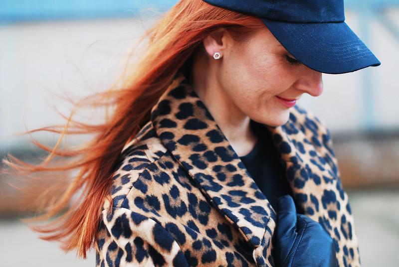 Leopard print coat with baseball cap
