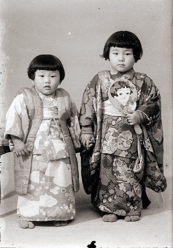 Young Japanese Girls in Kimono With Decorative Paddle