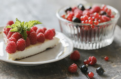 Cake with berries on vintage table