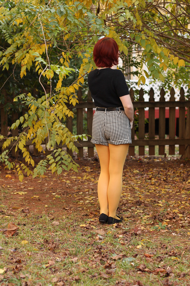 Yellow Tights, Houndstooth Shorts, and a Black Sweater