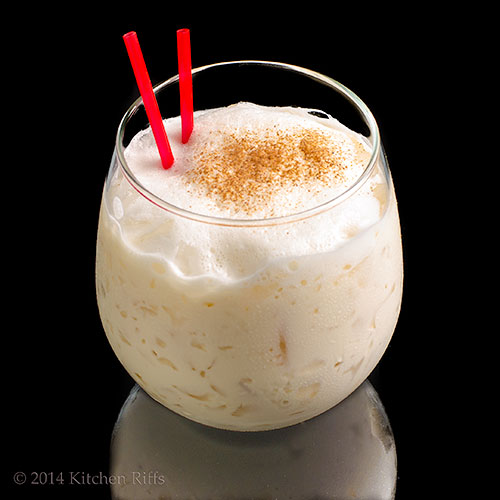 Milk Punch Cocktail in glass with grated nutmeg garnish