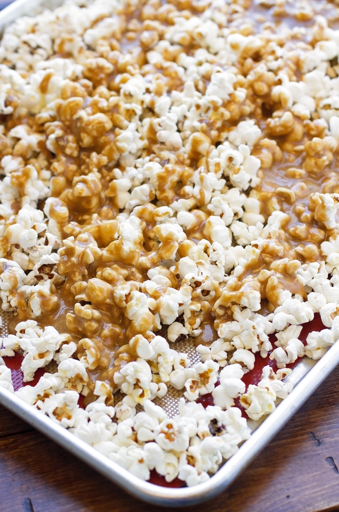 Homemade Caramel Corn - buttery and loaded with caramel this is the perfect movie night treat + it's perfect for gift giving! #popcorn #caramelcorn #gourmet #dessert   littlespicejar.com